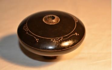 11 Black Yxing damper with flower designs 1900